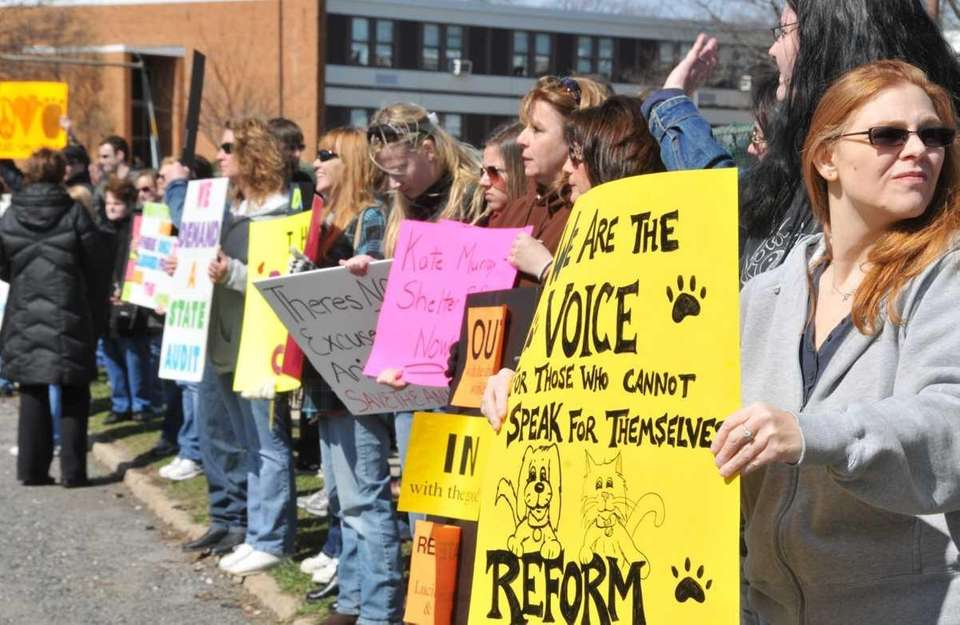 Community members and animal activists protest outside Hempstead