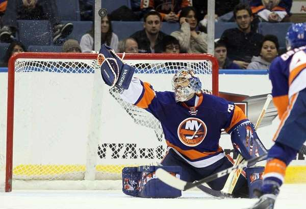 Rick DiPietro makes a glove save against the