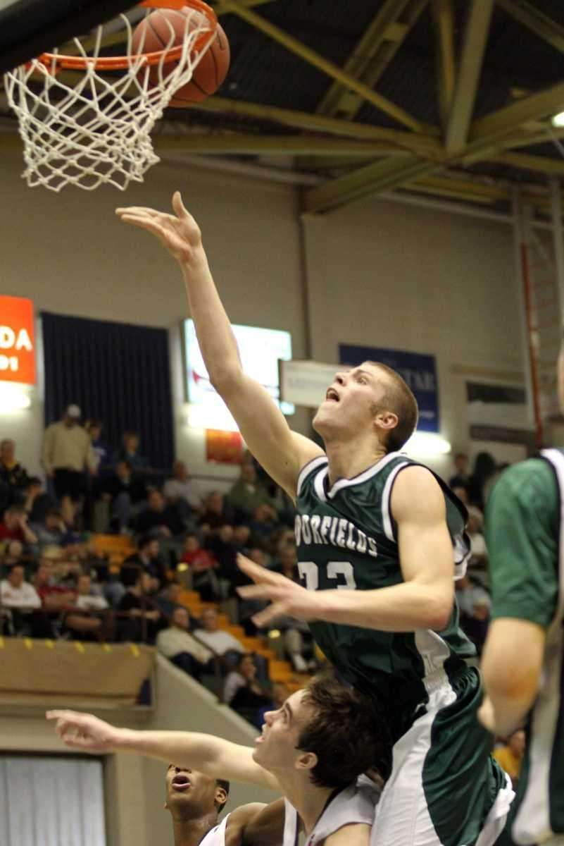 Harborfields' Nick Fessenden goes in for a layup