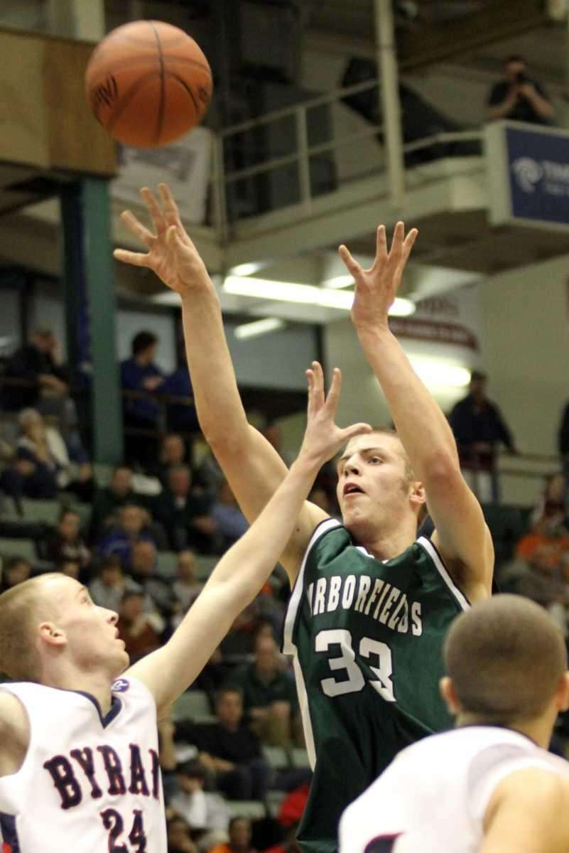 Harborfields' Nick Fessenden goes up for a shot