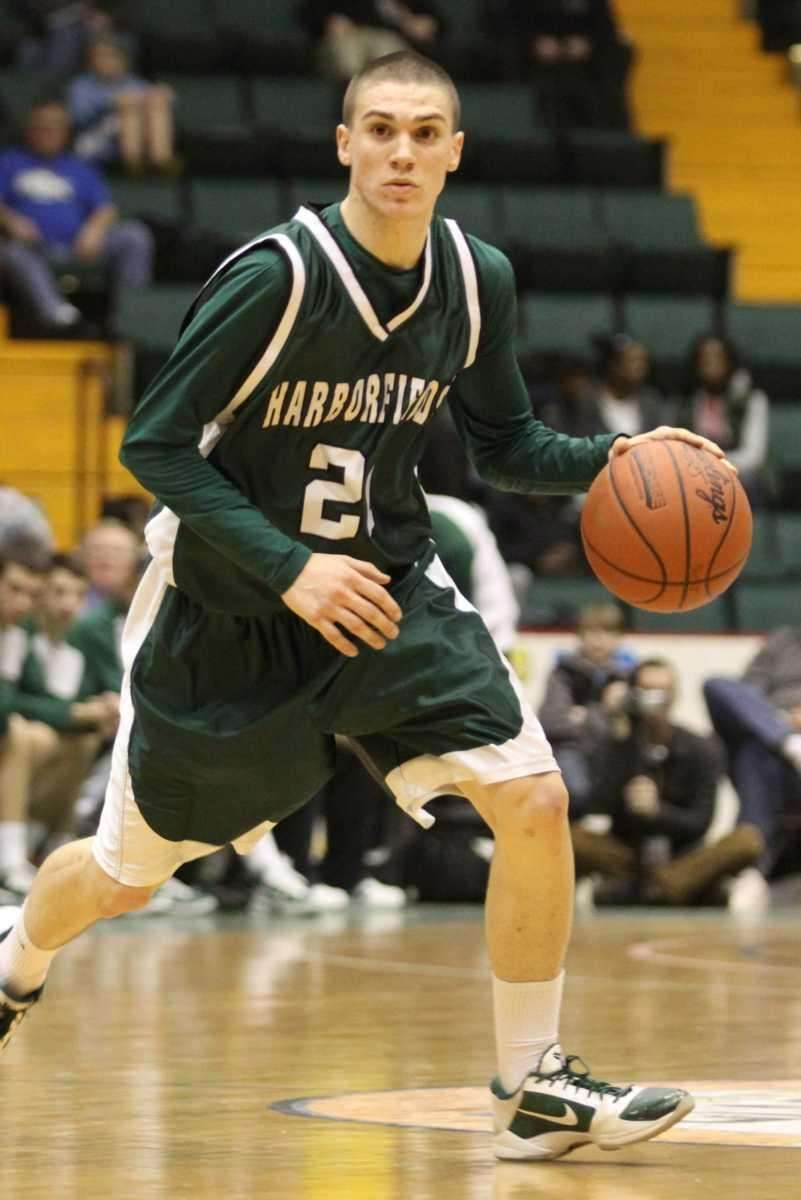 Harborfields' Joseph Savaglio brings the ball up against