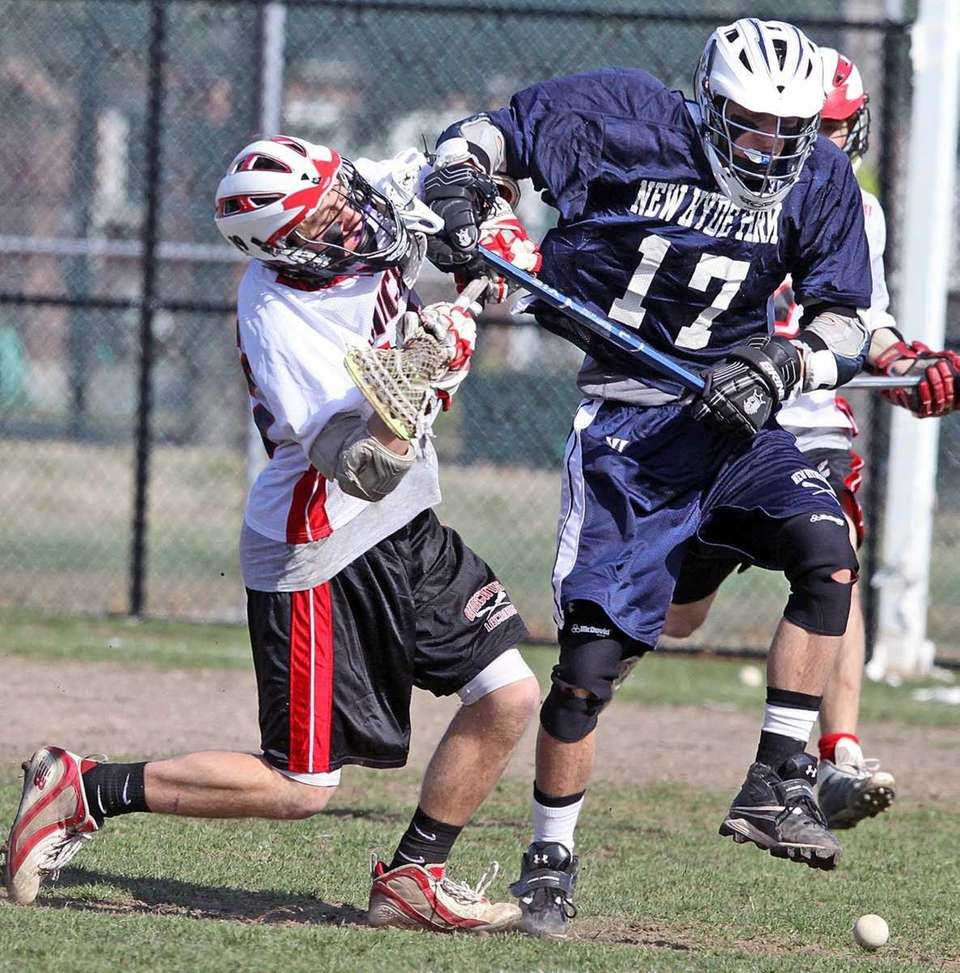 New Hyde Park's Alex Theodores, right, keeps the
