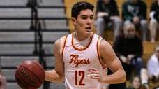 Michael O'Connell of Chaminade brings the ball downcourt