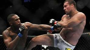 Mauricio Rua, right, kicks Jon Jones during their