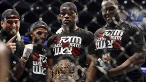 Jon Jones, second right, stands with others wearing