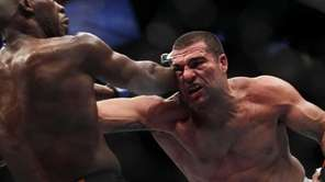 Jon Jones, left, hits Mauricio Rua during their