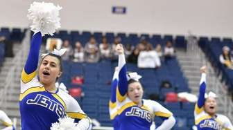 East Meadow cheerleaders perform during the Nassau cheerleading