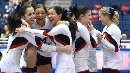 MacArthur cheerleaders react after the conclusion of their