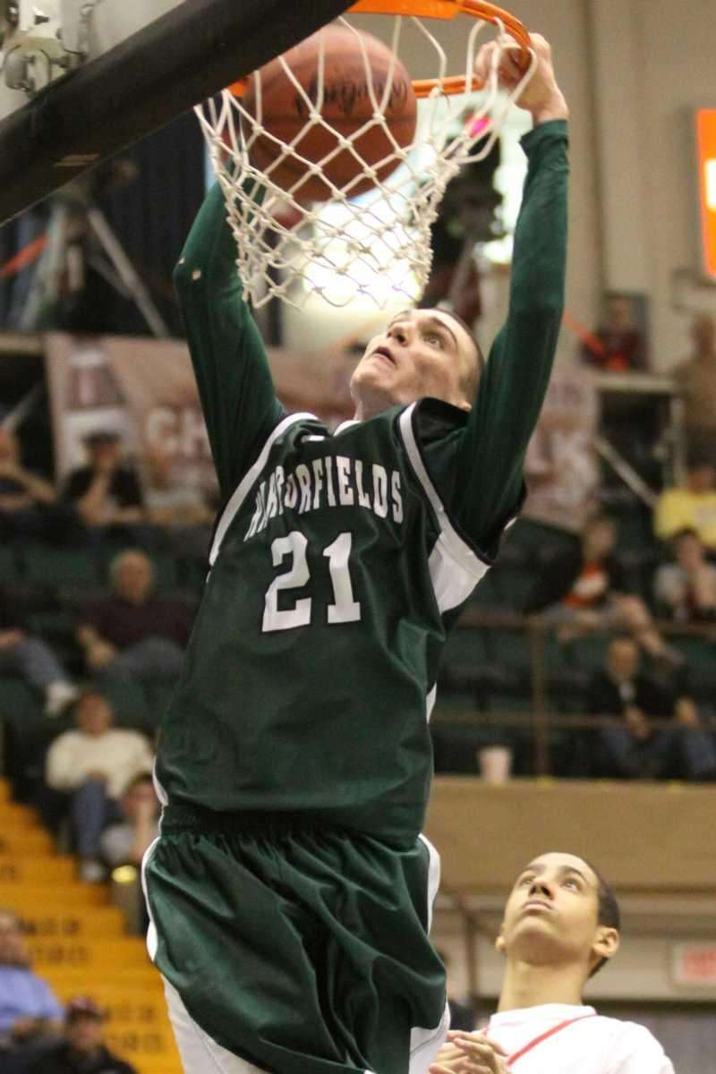 Harborfields' Joseph Savaglio goes in for the dunk