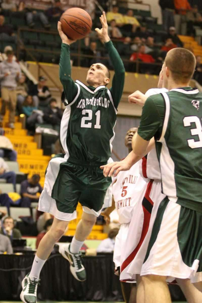 Harborfields' Joseph Savaglio goes in for a layup