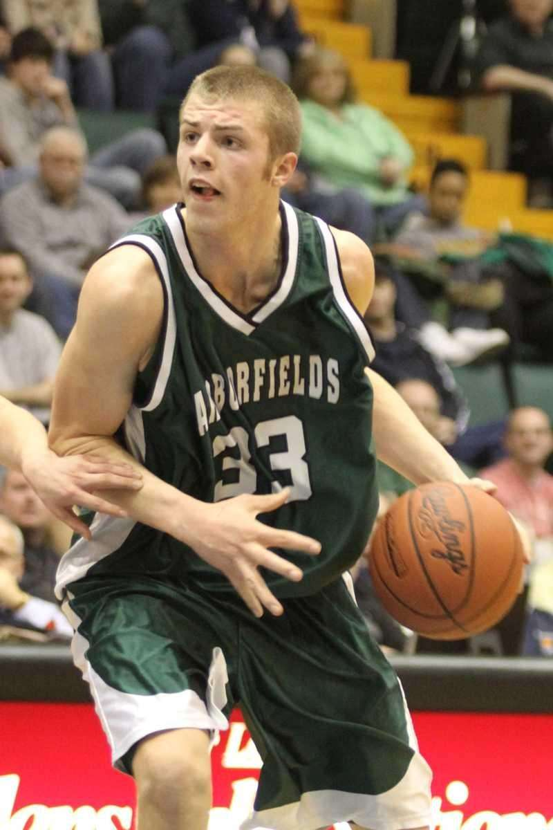 Harborfields' Nick Fessenden drives to the basket against