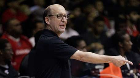 U.S. basketball coach Jeff Van Gundy speaks from