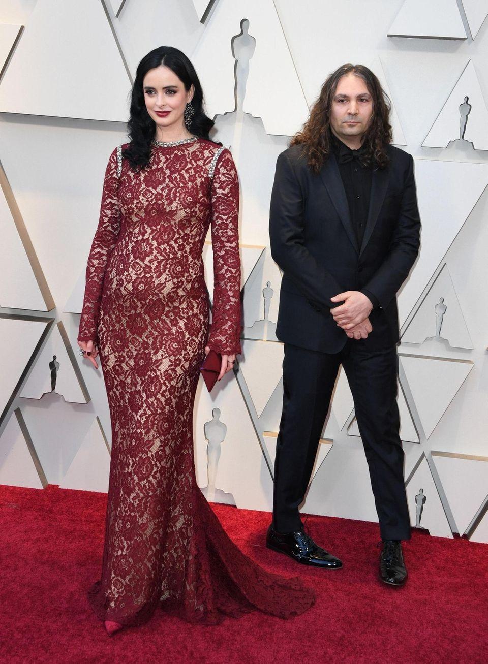 Actress Krysten Ritter (L) and Adam Granduciel arrive