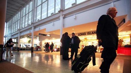 Passengers inside Islip's MacArthur Airport. (Jan. 7, 2010)