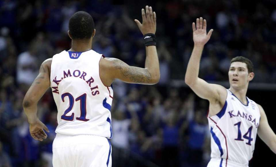 Kansas forward Markieff Morris, No. 21, and guard