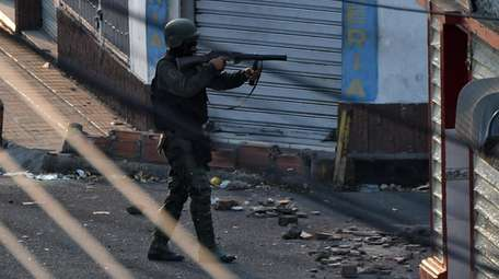 A member of the Venezuelan National Guard points