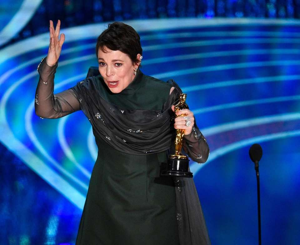 Olivia Colman reacts as she accepts the award
