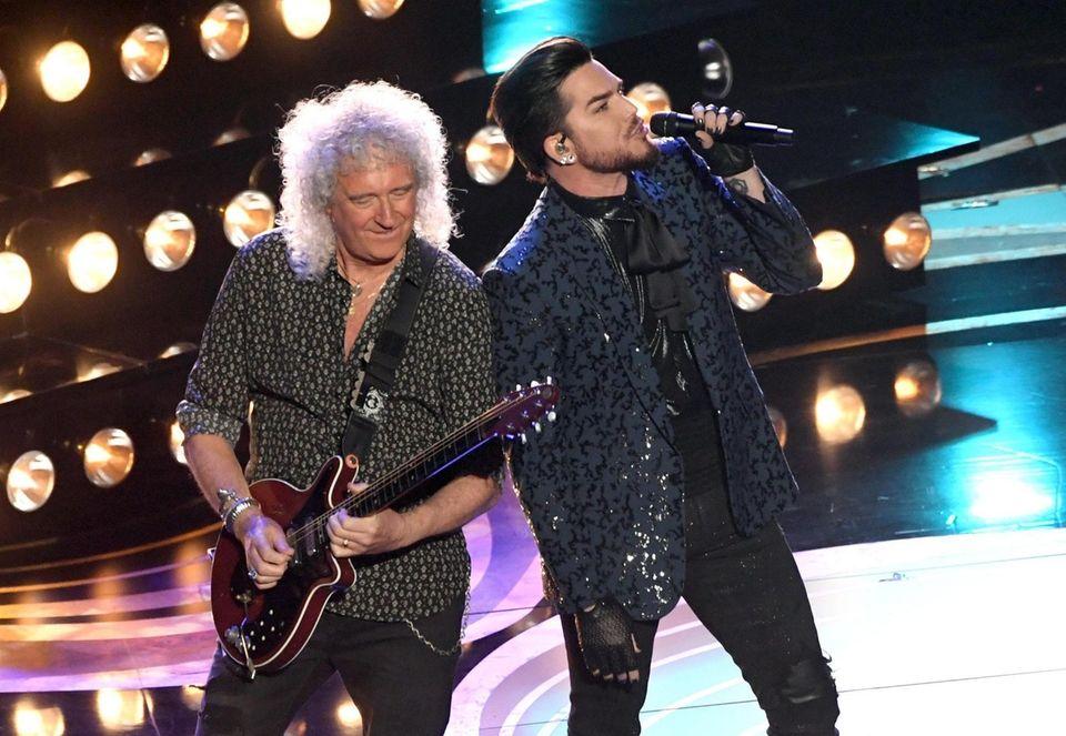 HOLLYWOOD, CALIFORNIA - FEBRUARY 24: Adam Lambert (L)
