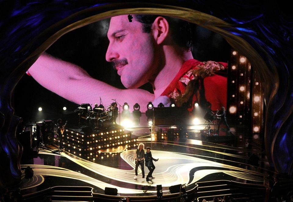 An image of Freddie Mercury appears on screen
