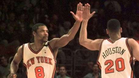New York Knicks' Latrell Sprewell high-fives with teammate