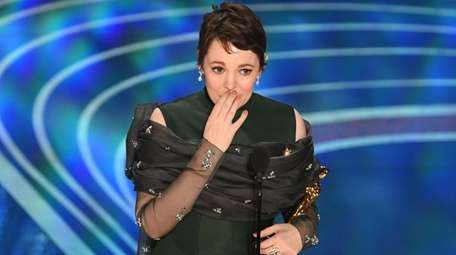 Olivia Colman accepts the award for best performance