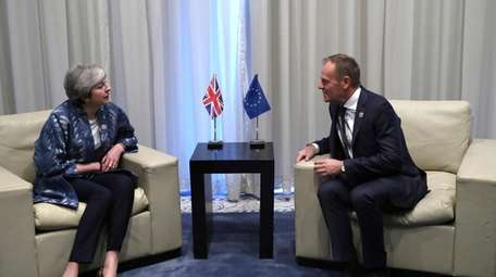 British Prime Minister Theresa May speaks with European