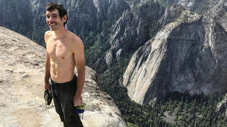 "In ""Free Solo,"" Alex Honnold holds all of"