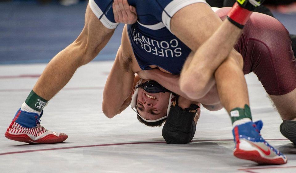 John GlennHigh School Thomas Giaramita wrestling in a