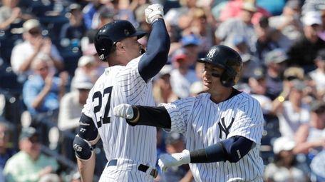 Yankees' Troy Tulowitzki, right, celebrates with Giancarlo Stanton