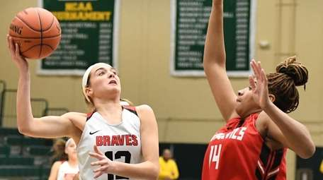 Syosset's Kendall Halpern puts up a shot defended