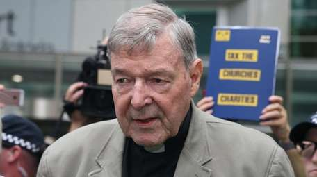 Cardinal George Pell leaves the County Court of
