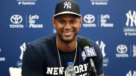 New York Yankees' Aaron Hicks smiles during a
