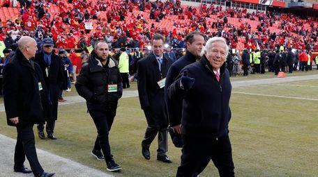 New England Patriots owner Robert Kraft, right, arrives
