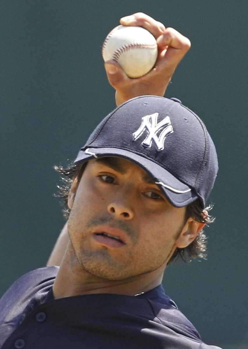 New York Yankees pitcher Sergio Mitre warms up