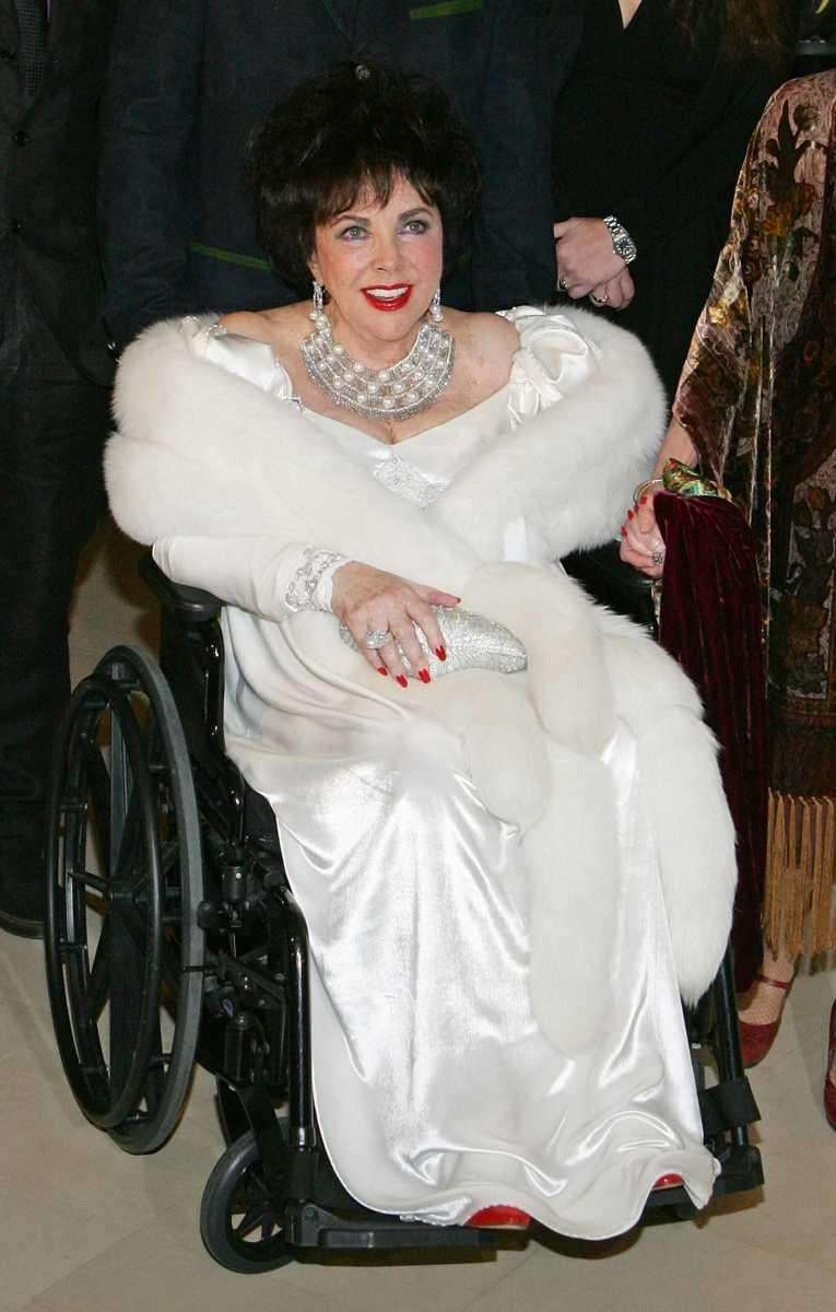 Dame Elizabeth Taylor arrives for her 75th birthday