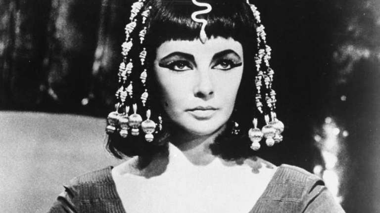 Elizabeth Taylor poses as Queen Cleopatra in this