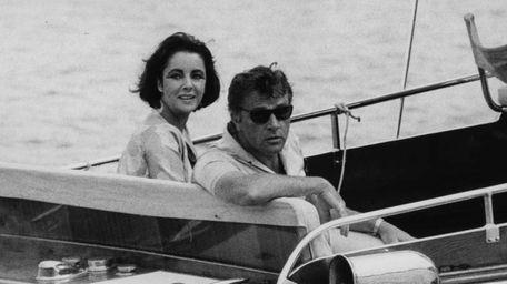 Richard Burton and Elizabeth Taylor arrive in a