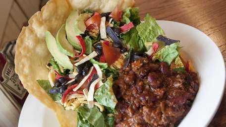 Southwestern salad is served in a tortilla bowl