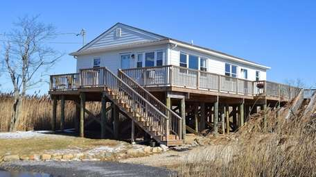 This Mastic Beach home is listed for $349,000.