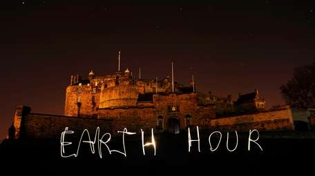 Edinburgh Castle before and during lights-out, as buildings