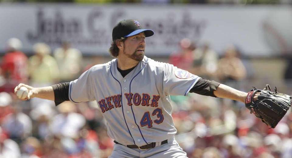 New York Mets starting pitcher R.A. Dickey throws