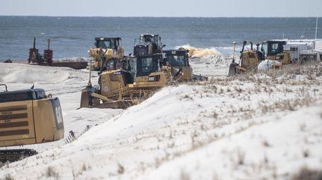 Sand replenishment underway at Gilgo Beach on Tuesday.