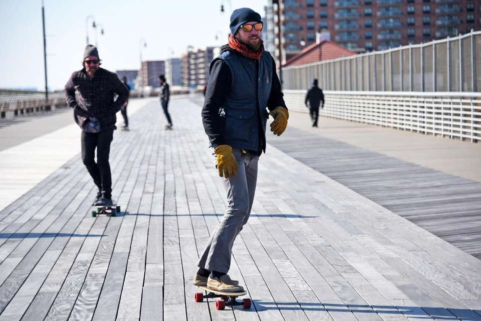 Skateboarders take advantage of a breezy but sunny