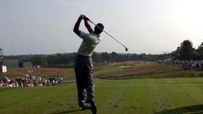 Tiger Woods tees off at the 14th tee