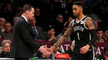 Nets head coach Kenny Atkinson greets D'Angelo Russell