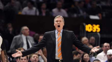 Mike D'Antoni yells toward the court while playing