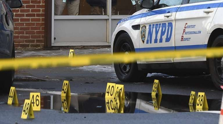 New York Police Department investigators at the scene
