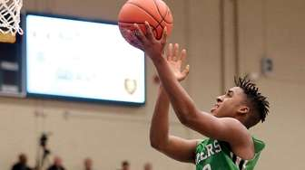 Farmingdale forward Luis Smikle Jr. drives the lane