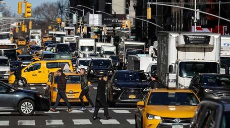Traffic moves along 7th Avenue in Manhattan on