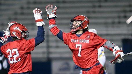 Stony Brook's Tom Haun congratulates teammate Jack Walsh